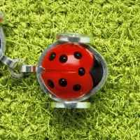 2002_ladybirds_necklace_on_greenlfy
